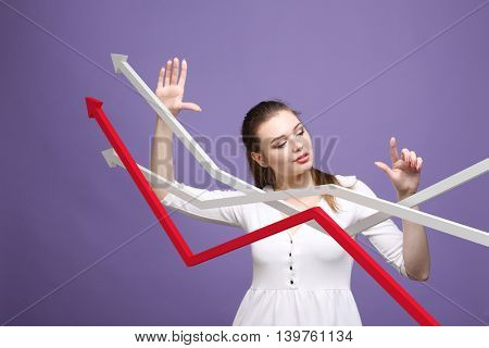 Businesswoman working with growth graph on violet background