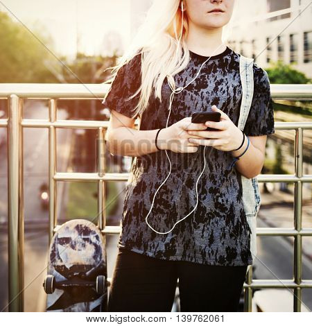 Young Woman Skater Browsing Phone Concept