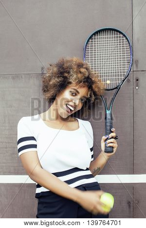 young stylish mulatto afro-american girl playing tennis, sport healthy lifestyle people concept closeup
