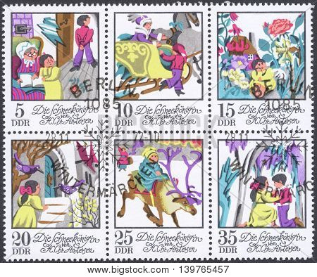 MOSCOW RUSSIA - CIRCA JANUARY 2016: a post stamp printed in DDR shows scenes from Andersen's fairy tales the series