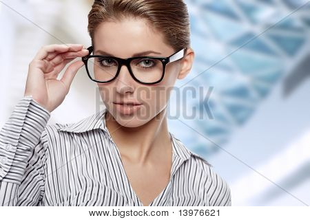Woman Wearing Glasses in office background