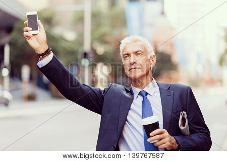 Businessman catching taxi in city