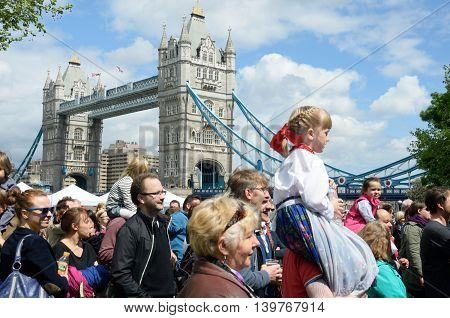 LONDON ENGLAND 9 May 2015: Small girl enjoying Polish day near tower bridge