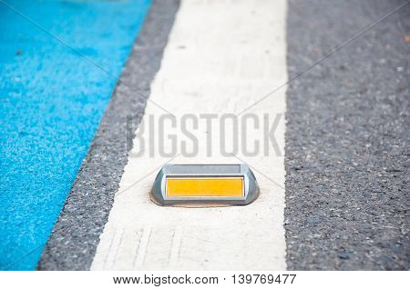 The Close Up Of Reflector Or Stud On Asphalt Road