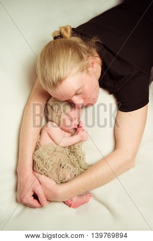 Caring parent's hands - father and newborn. Sweet dream