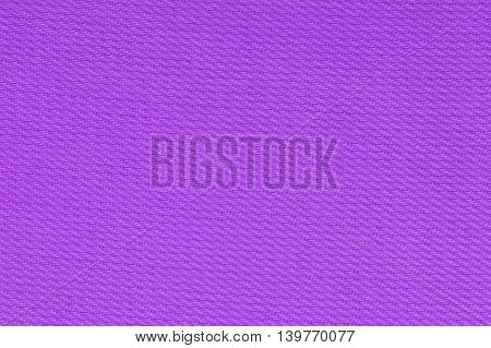 Purple decorative polyester fabric texture background, close up