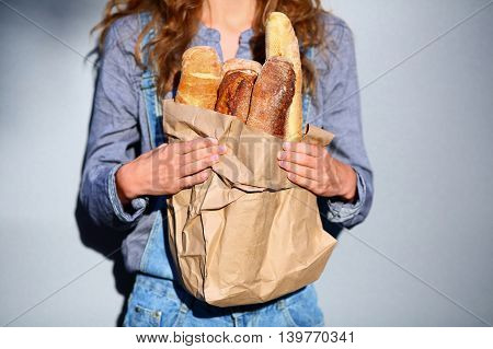 Paper Bag With Baguettes In A Hands Of Woman