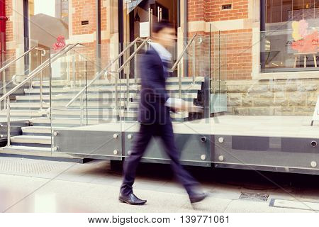 Blurred image of businessman walking