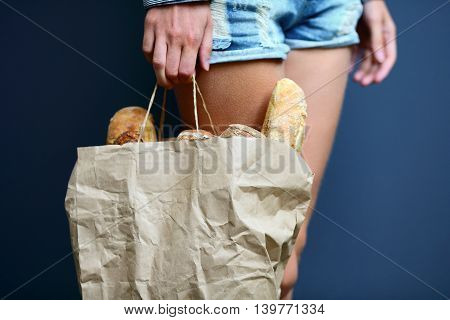 Paper Bag With French Baguettes In A Hand Of Woman