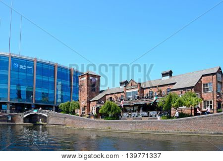 BIRMINGHAM, UNITED KINGDOM - JUNE 6, 2016 - View of The Malt House pub at Old Turn Junction with the National Indoor Arena aka the Barclaycard Arena to the rear Birmingham England UK Western Europe, June 6, 2016.