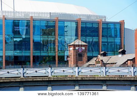 BIRMINGHAM, UNITED KINGDOM - JUNE 6, 2016 - View of the National Indoor Arena aka the Barclaycard Arena and the BIRMINGHAM, UNITED KINGDOM - JUNE 6, 2016 - Malt House Pub at Old Turn Junction Birmingham England UK Western Europe, June 6, 2016, June 6, 201