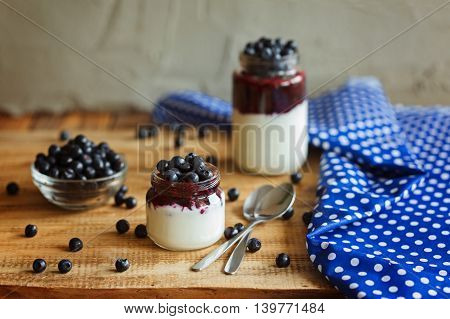 Healthy breakfast with  pudding and blueberries on wooden rustic background