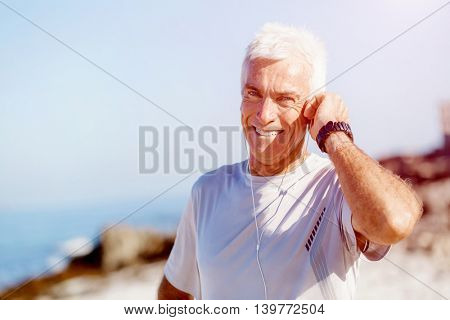 Sports and music. man getting ready for jogging