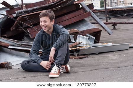 happy teenager on the roof of the of high house