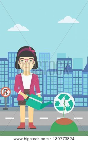 An asian young woman watering a tree with a recycle sign instead of crown on a city backround. Eco-friendly woman takes care of the environment. Vector flat design illustration. Vertical layout.