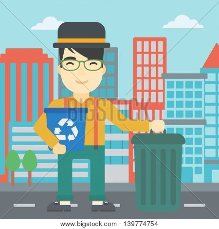 An asian young man carrying recycling bin. Man with recycling bin standing near a trash can on a city background. Vector flat design illustration. Square layout.
