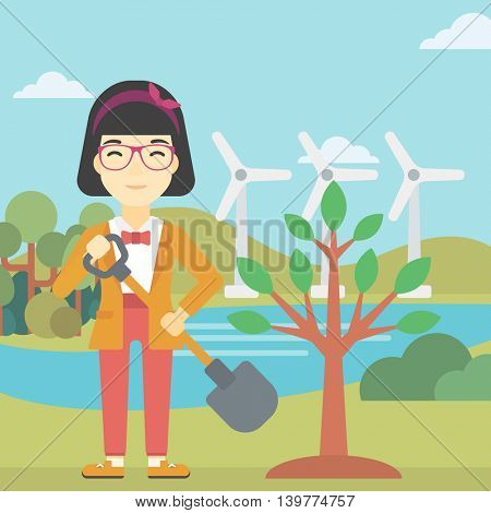 An asian young woman plants a tree. Woman standing with shovel near newly planted tree. Woman planting tree on a background of wind turbines. Vector flat design illustration. Square layout.