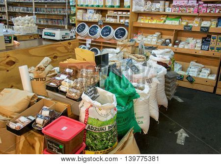 FREMANTLE,WA,AUSTRALIA-JUNE 25,2016: Organic markets stalls with bags of beans, muesli bins and other shelved products at the Fremantle Markets in Fremantle, Western Australia.