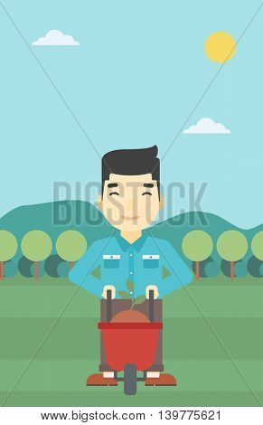 An asian young man standing with a plant and soil in a wheelbarrow on the background of mountain landscape. Vector flat design illustration. Vertical layout.