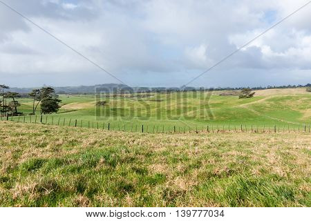 Rolling Farmland to distant horizon under dark overcast sky