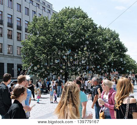 PRAGUE, CZECH REPUBLIC - JUNE 17, 2016: Holiday soap bubbles in the street in Prague