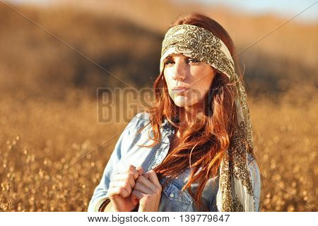 Young Beautiful Woman in a Field During Summertime