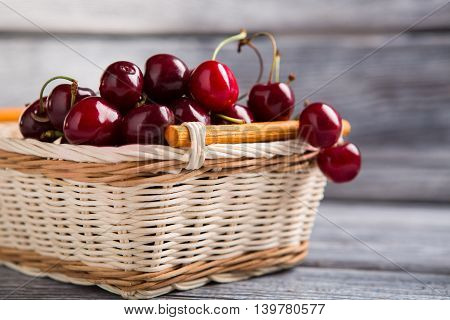 Basket filled with cherries. Dark red fruit. Improve kidney health. Fresh and sweet.