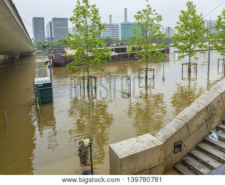 Paris,France - June 05 2016: The embankment of River Seine is covered by water after the massive flooding in Paris during the first days of June 2016.
