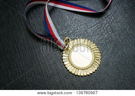 Award For A Winner - Gold Medal On Black Background.