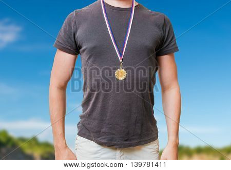 Man Is Wearing Golden Medal On His Chest.
