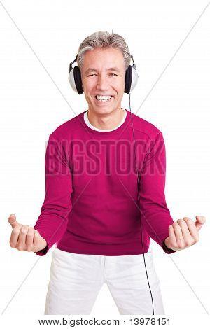 Happy Man With Headphones Dancing