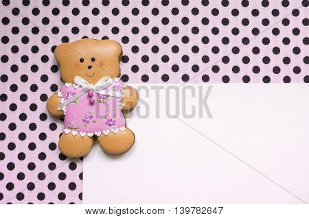 A cute polka dot background with a handmade honey-cake bear and a place for your text for a baby shower party, a birthday party or other events.