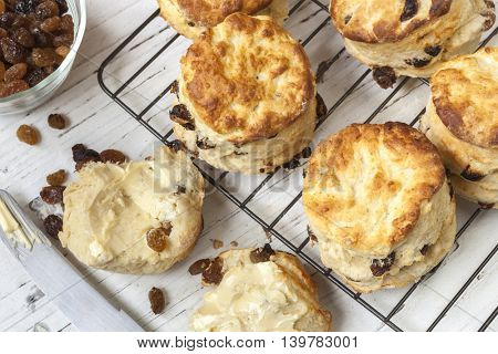 Fruit scones on rack.  Top view.  With sultanas and butter.