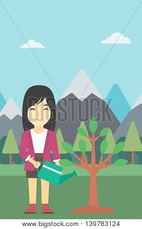 An asian woman watering a tree on the background with mountain. Young friendly woman takes care of the environment. Vector flat design illustration. Vertical layout.
