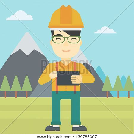An asian man in hardhat holding a tablet computer in hands on the background of mountain landscape. Man working on digital tablet. Vector flat design illustration. Square layout.