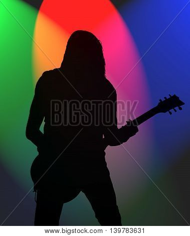 illustration of silhouette of a rock guitarist in blue, red, purple  and green spotlights