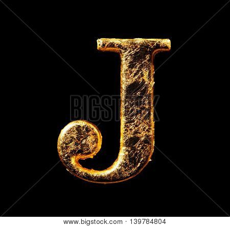 Alphabet and numbers in gold leaf isolated on black