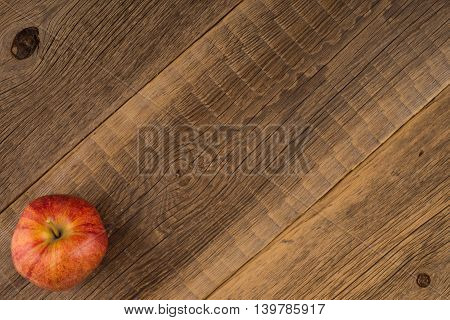 Red apple on old wooden table.Red apple on old wooden table