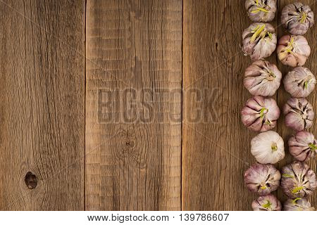 sprouted garlic on a old wooden table