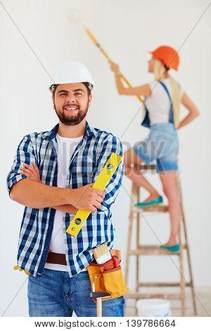 portrait of professional repair team at work