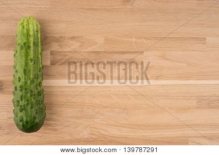 Cucumber on an old wooden table.Cucumbers on a wooden background.
