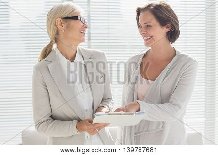 Happy woman with her therapist at home