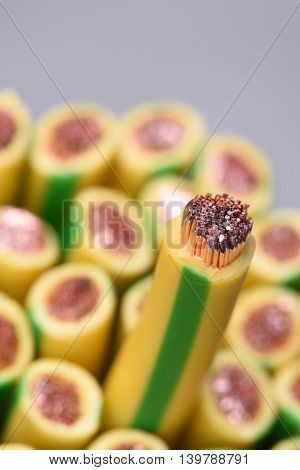 Group of yellow and green earth cables and selective focus on one closeup