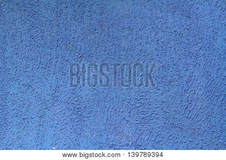 Blue painted brick wall as background texture