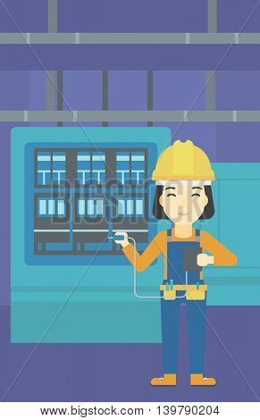 An asian woman in helmet measuring the voltage output. Young electrician with electrical equipment standing in front of switchboard. Vector flat design illustration. Vertical layout.