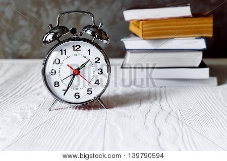 metal alarm clock time to read books