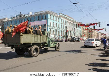 St. Petersburg, Russia - 9 May, Military truck with people on Nevsky prspekte, 9 May, 2016. Celebration day of victory in the center of St. Petersburg.