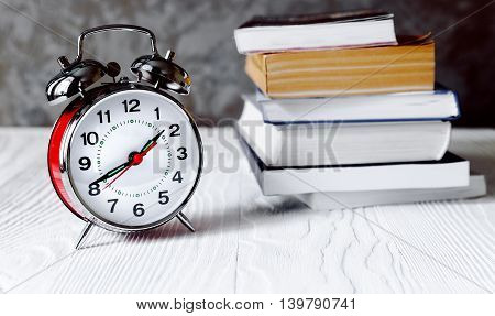 metal alarm clock time to read books close up