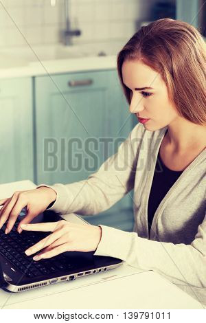 Beautiful caucasian woman working on laptop.