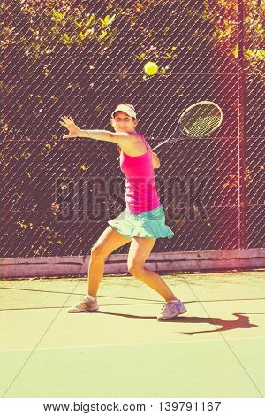 Pretty young woman playing tennis